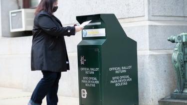 Voter drops off her ballot in Phliadelphia
