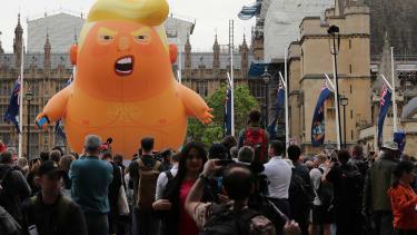 """A """"Baby Tump"""" balloon flies over London."""