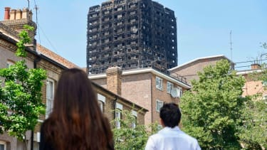 People looking at Grenfell Tower.