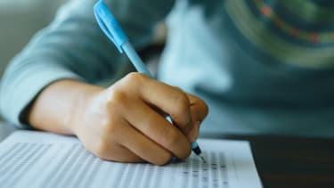Student takes exam.
