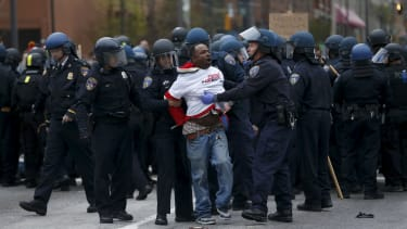 Police detain a protester in Baltimore.