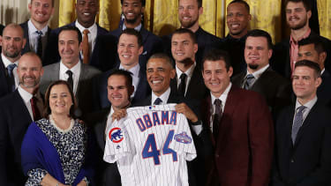 Barack Obama and Chicago Cubs players.