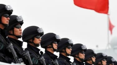 """Chinese soldiers on a warship in November 2010: The communist country's """"relentless"""" military buildup should not be taken lightly, says Aaron L. Friedberg in The New York Times."""