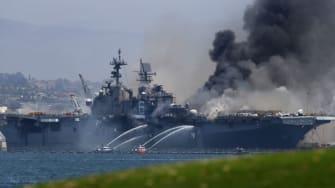 USS Bonhomme Richard burns at naval base in San Diego.