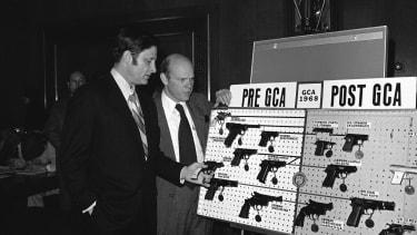 Former Senator Birch Bayh and David MacDonald, former assistant secretary of treasury.