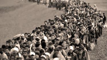 Refugees are escorted through Slovenia.