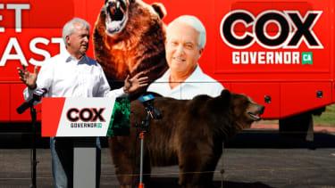 John Cox and Tag the bear.
