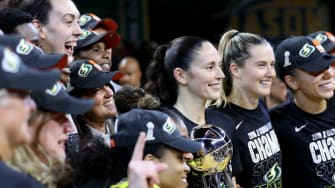 Seattle Storm players pose with WNBA Championship trophy.