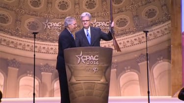Mitch McConnell wins CPAC 2014 by strolling on stage with a gun