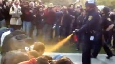 A California cop pepper sprays peaceful protesters at the University of California, Davis