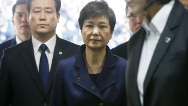 Ousted South Korean president Park Guen-hye is escorted to jail