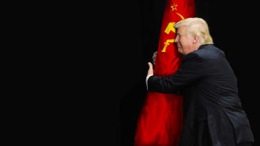 President Trump hugging hammer and sickle flag.