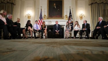 President Donald Trump listens to survivors of school shootings.