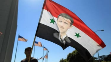 A supporter of Syrian President Bashar al-Assad waves a flag at a Sept. 7 rally in Los Angeles.