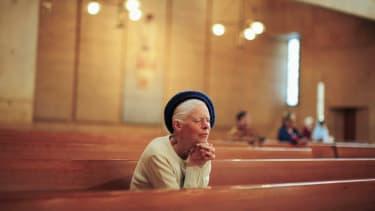 The faithful pray in a Los Angeles church.