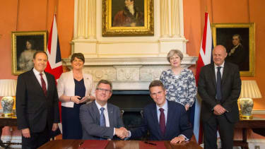 Theresa May and her party sign a governing agreement with Irish unionists