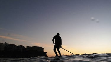 A man crossed the Atlantic Ocean on a paddleboard.