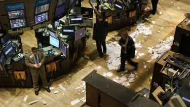 Stock brokers walk around a destroyed exchange floor after the 2008 economic crisis