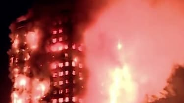 An apartment tower burns in London