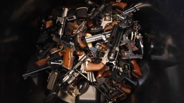 Handguns in a pile