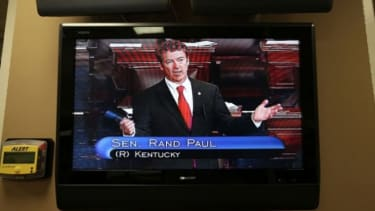 """Sen. Rand Paul, as seen through a TV monitor, participates in his """"talking filibuster"""" on March 6."""