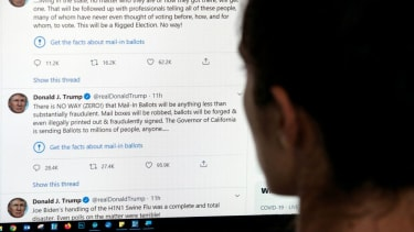 A person looks at Trump's tweets on a computer screen.