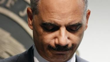 Attorney General Eric Holder was held in contempt of Congress on Thursday, with 17 Democrats siding with the Republican majority against Holder.