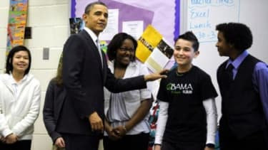 Obama visits with middle schoolers in Virginia before giving a speech vowing to reform the No Child Left Behind Act before the next school year.