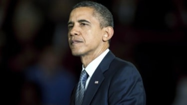 President Barack Obama pauses during an economic speech in Kansas in which he invoked the legacy of Republican President Teddy Roosevelt, who focused relentlessly on the middle class.