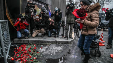 A woman places flowers outside the Reina nightclub in Istanbul