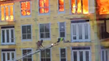 Incredible video shows a worker's dangerous rescue from a burning Houston building