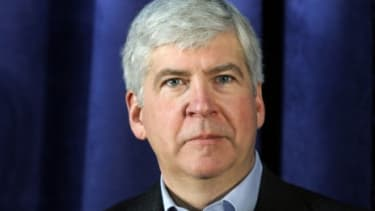 Gov. Rick Snyder (R-Mich.) signed a new law that was immediately rebuked by union leaders because it empowers emergency fiscal managers who could void union contracts.