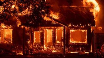 A house burns in Paradise, California.