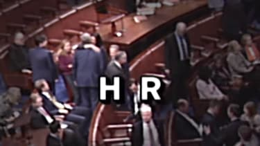 Reps. Mark Meadows and Rashida Tlaib hug it out