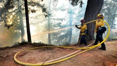Firefighters battling the Bobcat fire near Mount Wilson Observatory.