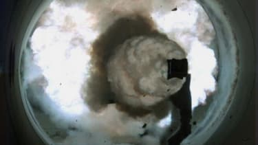 A high-speed camera image of the Electromagnetic Railgun -- an electrically powered, long-range gun launch system.