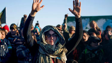 Activists celebrate at Oceti Sakowin Camp on the edge of the Standing Rock Sioux Reservation on December 4, 2016 outside Cannon Ball, North Dakota, after hearing that the Army Corps of Engine