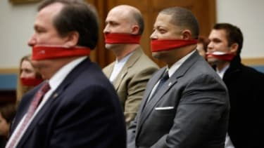 """Supporters of a woman's right to choose abortion stand in silent protest during a """"No Taxpayer Funding For Abortion Act"""" hearing Tuesday."""