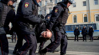 Police arrest a protester in Moscow