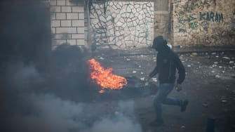 Israel reopens holy site as tensions rise