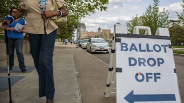 People drop off their ballots in Dayton, Ohio, this April.