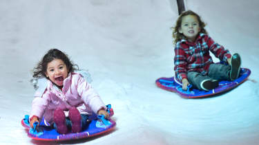 Young children enjoy the rides in Penny's Snow Place at Winterfest, southern California's newest wintertime experience