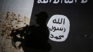 An ISIS flag painted on a wall.