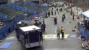 Police descend on the Boston Marathon finish line.