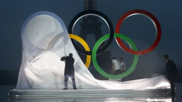 Paris unveils a display of the Olympics rings in front of the Eiffel Tower.
