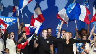 Marine Le Pen and her supporters sing the French national anthem.
