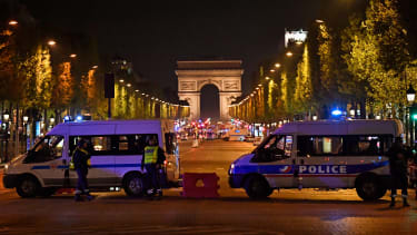 French police secure an area after a shooting in Paris
