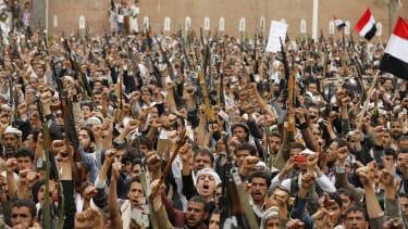 Shi'ite Muslim rebels rally against Saudi Arabia-led air strikes in Syria.