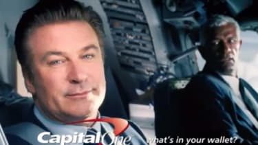 Alec Baldwin stars in a Capital One commercial: The credit card company is the first charged by the Consumer Financial Protection Bureau on charges of misleading customers into purchasing pro