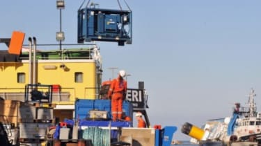 A salvage team prepares to begin recovering thousands of tons of fuel from the capsized Costa Concordia.
